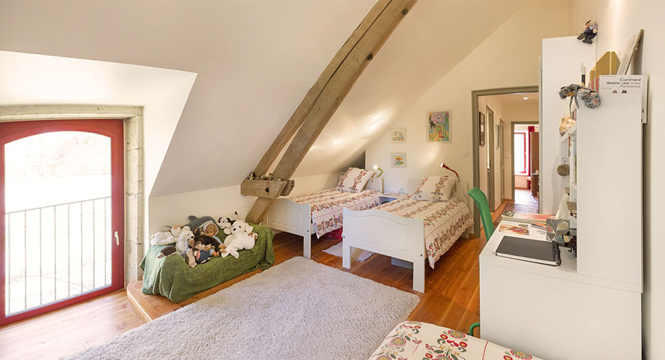 "Additional three single beds in the main house, for the ""True French Experience"" offering"