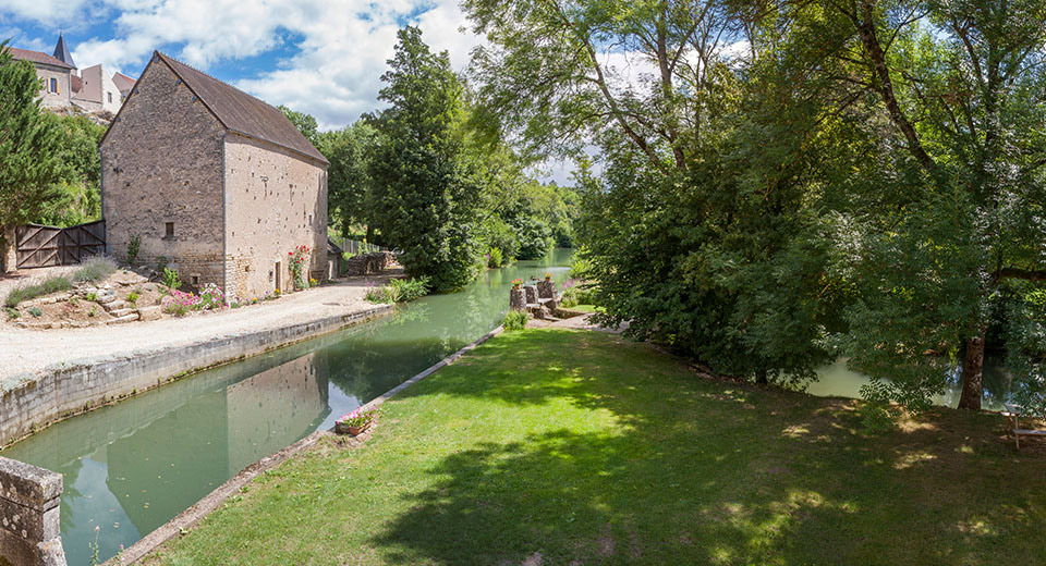 Seen from your cottage, the river, the mill stream, the barn and the village
